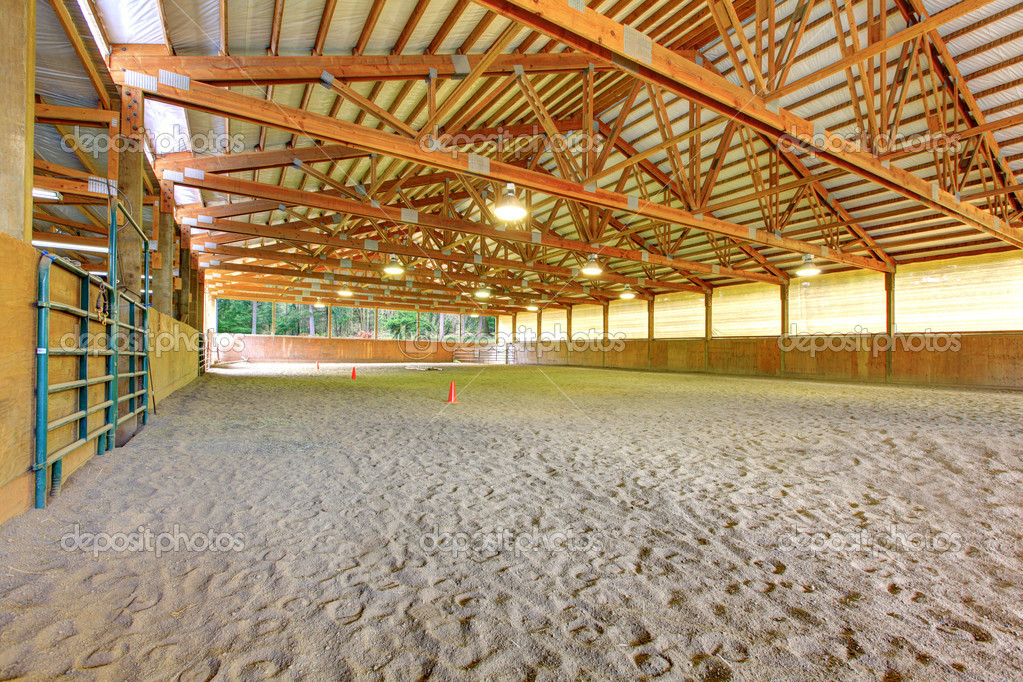 Large Horse Arena Riding Area With Sand Interior Stock