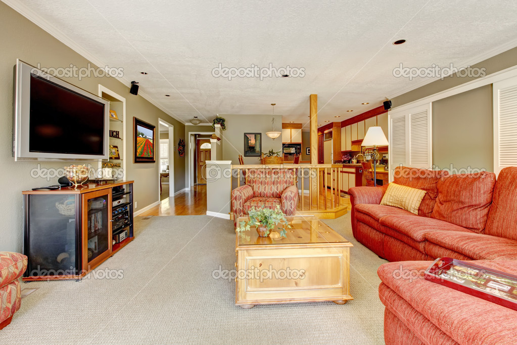 living room interior with red sofa tv and beige colors stock photo iriana88w 11886636. Black Bedroom Furniture Sets. Home Design Ideas