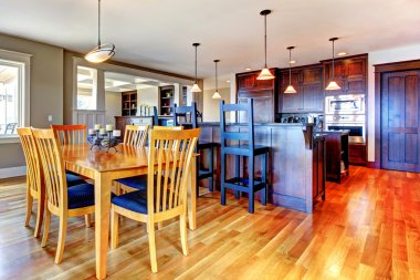 Luxury home kitchen and dining room with open floor plan.