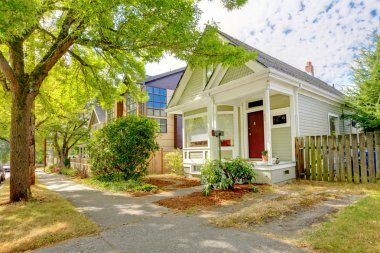 Small cute craftsman American house wth green and white.