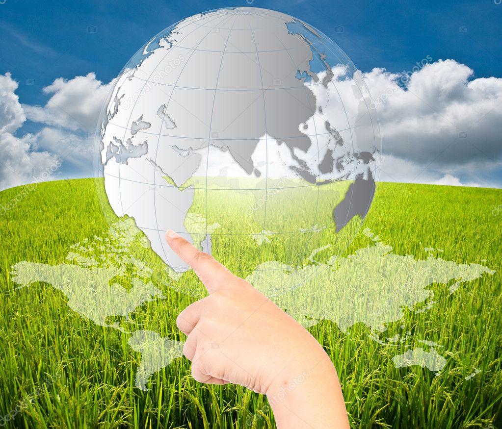Globe on the blue sky field
