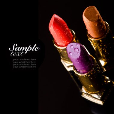 Lipsticks on black background
