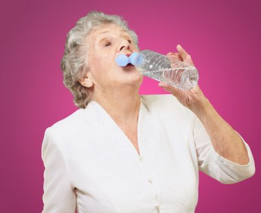 Mature Thirsty Woman Drinking Water