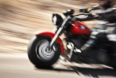 Abstract slow motion, biker riding motorbike