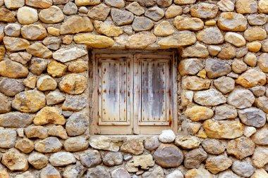 Masonry stone wall with grunge wood window