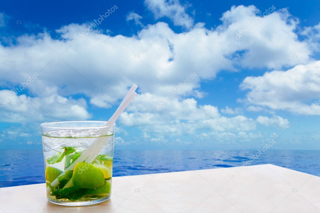 Mojito cocktail drink in summer blue calm sea