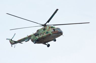 Russian military helicopter MI-8 in cloudy sky