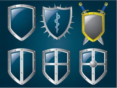 Metallic shiny shields set stock vector
