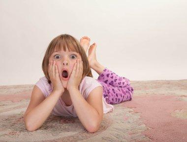 Little girl looking surprised