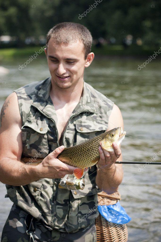 Happy angler with a big freshwater chub.
