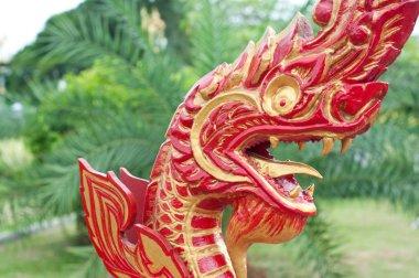 Thai wood carving king of naga