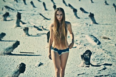 Sexy young topless girl in a deserted place