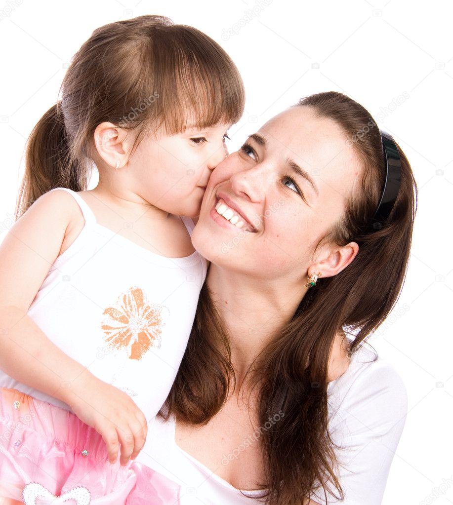 A lovely little girl kissing her mother