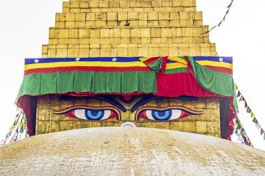 Bodhnath stupa in kathmandu with buddha eyes and prayer flags wi