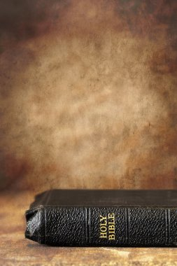 Old Holy Bible, over a grunge stone background. Lots of copyspace. stock vector