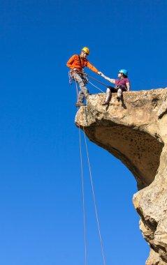 Climbing team struggles to the summit.