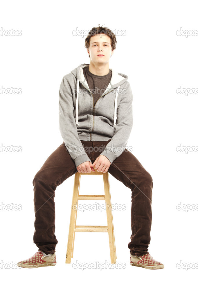 Young Man With Hip Style Sitting On Stool Stock Photo