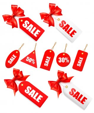 Big set of sales tags with red gift bow and ribbons