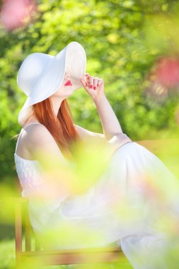 Mysterious girl in a garden