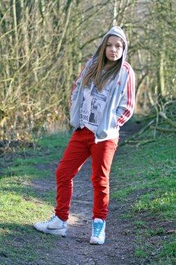 Teenage girl in the woods