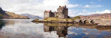 Panorama Reflection of Eilean Donan Castle, Highland Scotland. stock vector