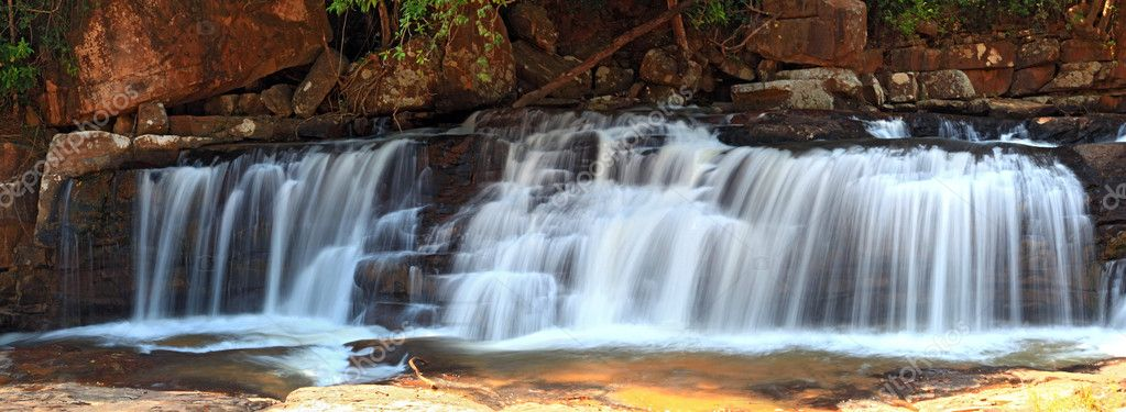 Panoramic view of tropical Tadtone waterfall in rain forest in C