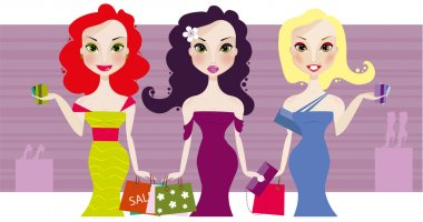 Three cute smiling girls with shopping bags and credit cards
