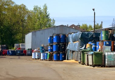 Factory of hazardous waste. Containers of hazardous waste.