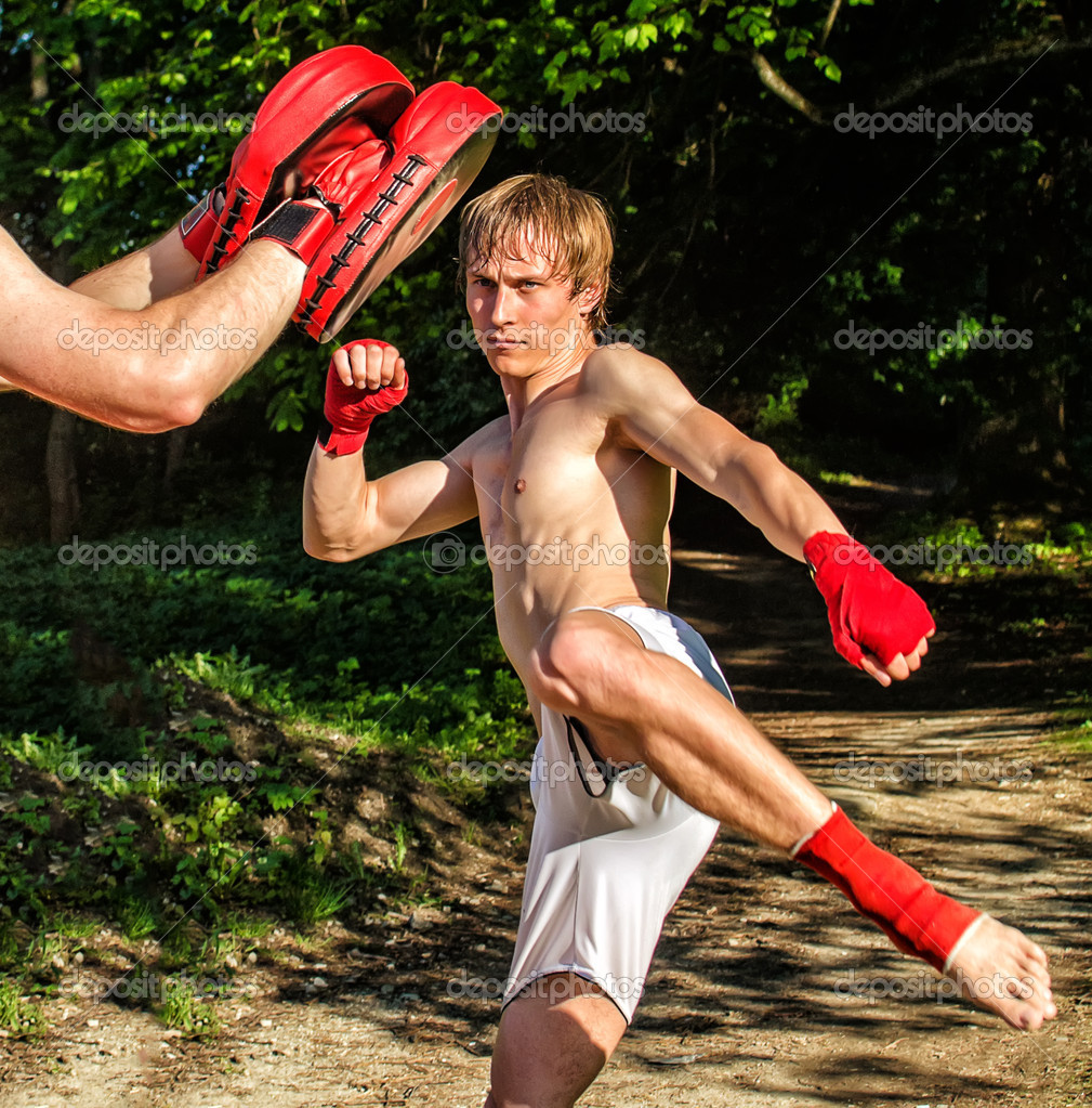 Two man training Muay thai in forest