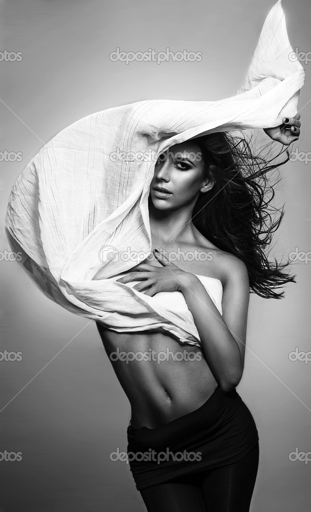 Young Fashion Greek Model Holding A White Black Fabric Blown By The Wind Isolated Studio Shot Photo Appearagain