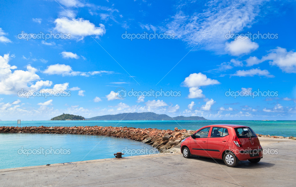 Car on tropical beach