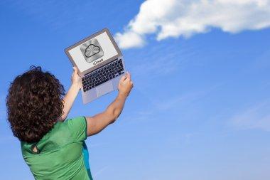 Girl using iCloud laptop