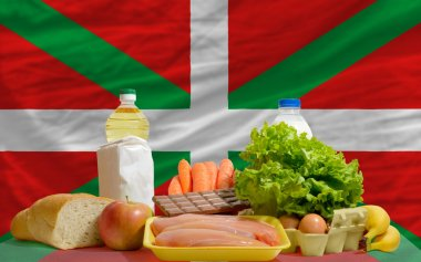 Basic food groceries in front of basque national flag
