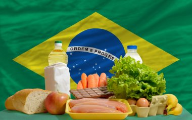 Basic food groceries in front of brazil national flag