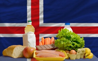 Basic food groceries in front of iceland national flag