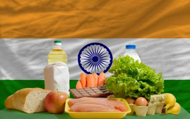 Basic food groceries in front of india national flag