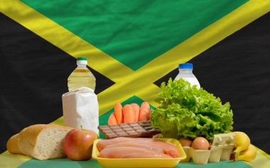 Basic food groceries in front of jamaica national flag