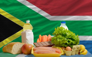 Basic food groceries in front of south africa national flag
