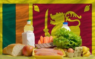 Basic food groceries in front of sri lanka national flag