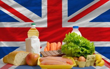 Basic food groceries in front of united kingdom national flag
