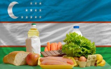 Basic food groceries in front of uzbekistan national flag