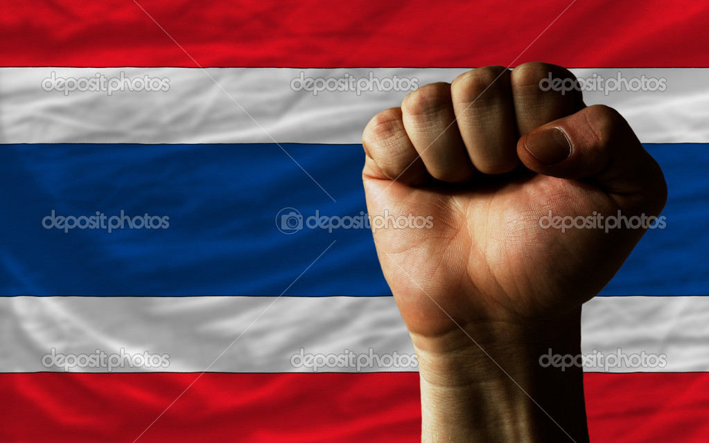 Hard fist in front of thailand flag symbolizing power
