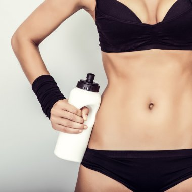 Fitness girl with water close up