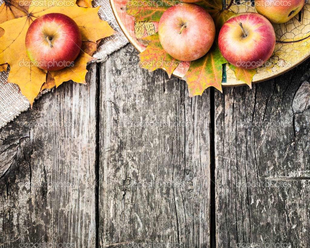 Autumn border from apples and yellow leaves