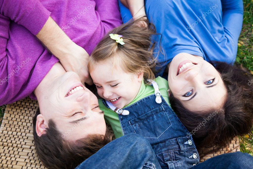Portrait of family lying outdoors