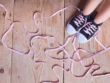 The problem - child feet and long twisted shoelaces
