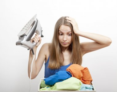 Woman wth laundry and iron