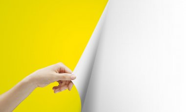 Hand turns yellow page