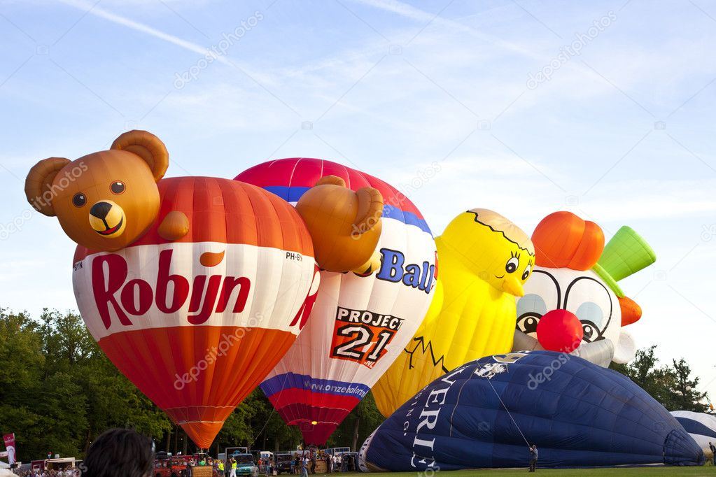 BARNEVELD, THE NETHERLANDS - 17 AUGUST 2012: Colorful air balloons taking off at international balloon festival Ballonfiesta in Barneveld on August 17 in Barneveld, The Netherlands