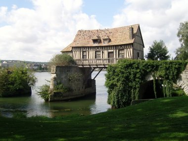 Old mill in the bridge on the Seine at Vernon in Normandy France